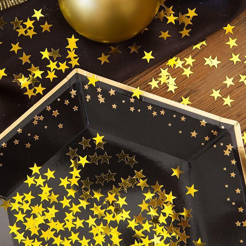Konfetti w kształcie złotych gwiazdek