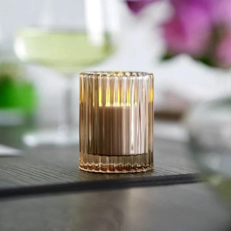 Szklany świecznik na tealighty w kremowym odcieniu