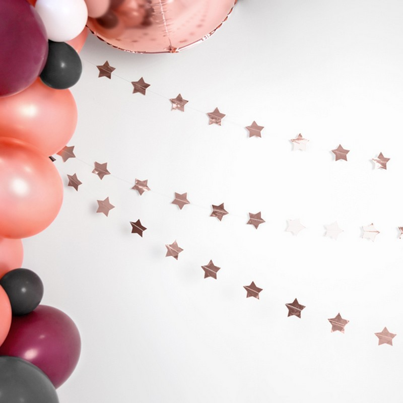 Girlanda gwiazdki rosegold do dekoracji sali i candy baru na urodzinki