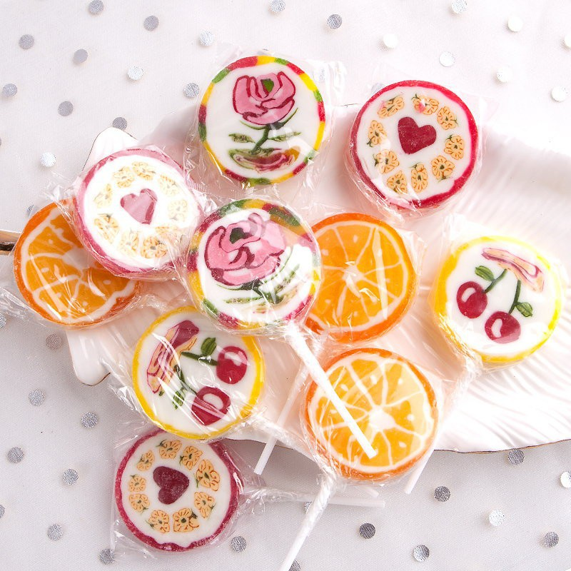Kolorowe lizaki dla dzieci do słodkiego stołu na Roczek
